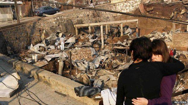 Residents survey the damage in Valparaiso, April 13, 2014.