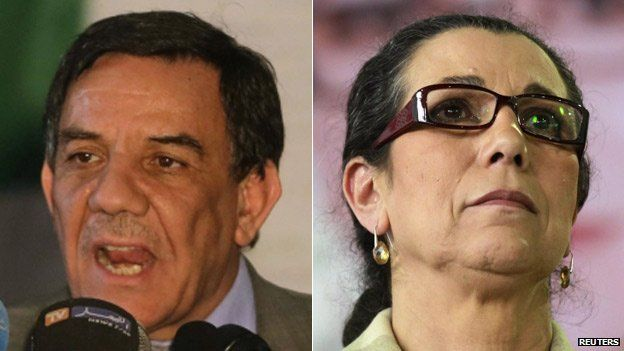 Leader of the Algerian National Front Moussa Touati (L) and Workers Party head Louisa Hanoune