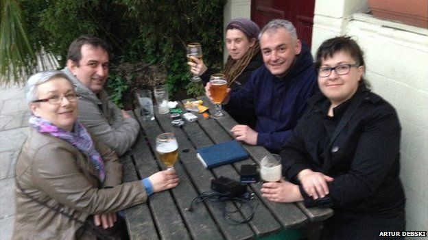 Artur Debski sitting at an outdoor pub table