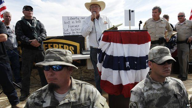 Nevada rancher Cliven Bundy addresses a crowd of protestors near his ranch on 12 April, 2014.