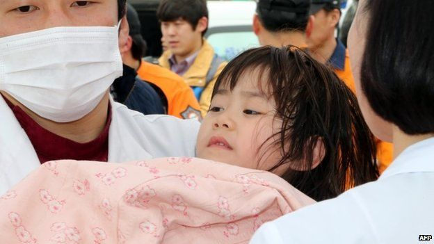 Rescued girl being brought onto land in Jindo