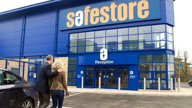 A couple enter a self-storage unit in Staines