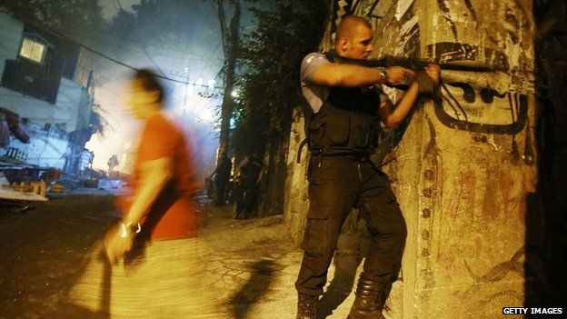 Brazilian police patrol following shootings in the pacified Pavao-Pavaozinho community, just blocks from Copacabana Beach on 22 April, 201