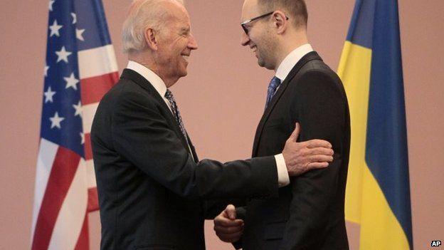 Joe Biden, left, talks to Ukrainian Prime Minister Arseniy Yatsenyuk during a meeting in Kiev, April. 22