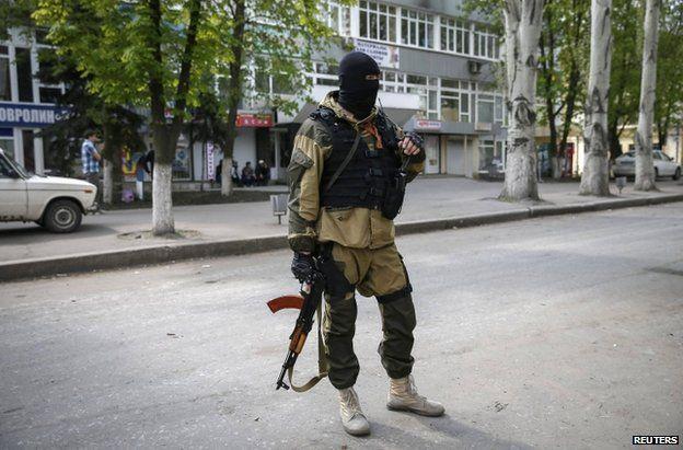 A masked pro-Russian gunman in Sloviansk, eastern Ukraine, 23 April