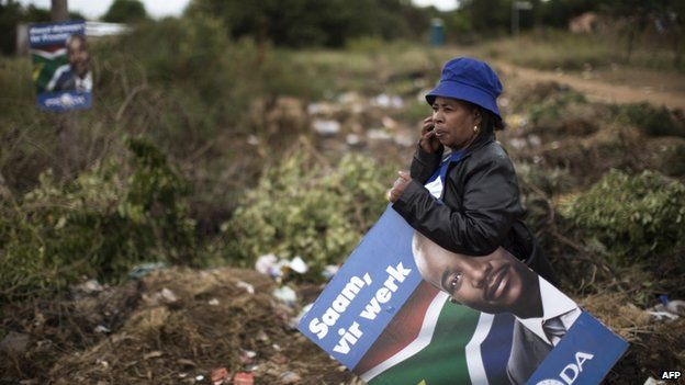 A supporter of the leader of South African opposition Democratic Alliance (DA) which one of their posters - 16 April 2014