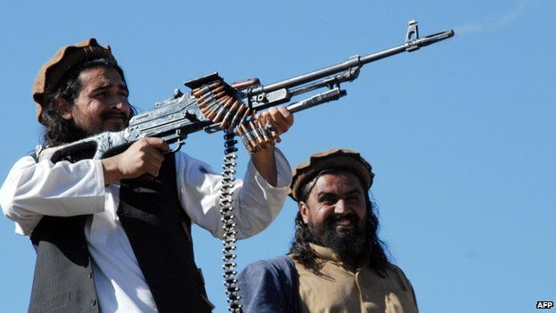 File photo: Pakistani Taliban commander Hakimullah Mehsud poses and fires bullets for a group of media representatives in the Mamouzai area of Orakzai Agency, Pakistan, 26 November 2008