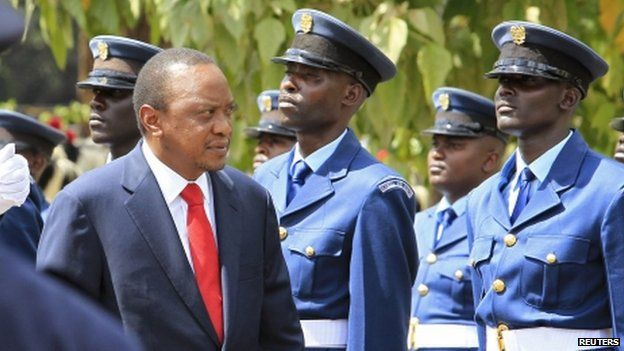 Kenyan President Uhuru Kenyatta inspects a guard of honour as he arrives at parliament in Nairobi - March 2014