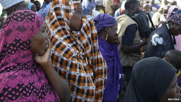 Mothers of kidnapped school girls react during a meeting with the Borno State governor in Chibok - 22 April 2014