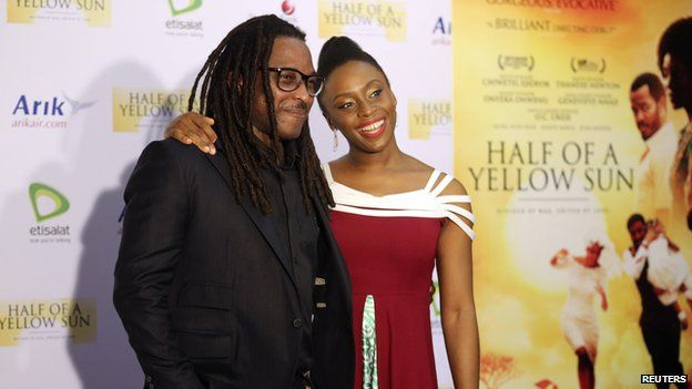 Director of Half of a Yellow Sun Biyi Bandele (l) and author Chimamanda Ngozi Adichie attend the film's premiere in Lagos on 12 April