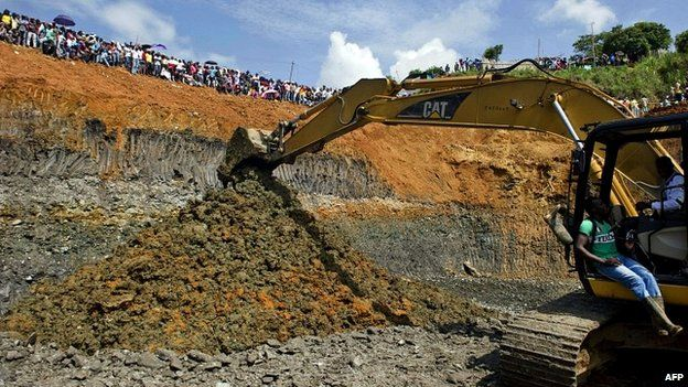 Rescuers work on the removal of sludge in Santander de Quilichao, Colombia - 1 May 2014