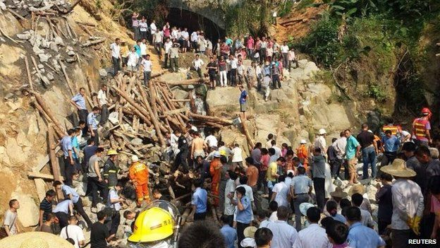 Rescue workers at a bridge that collapsed during construction in Maoming, Guangdong province, 3 May 2014