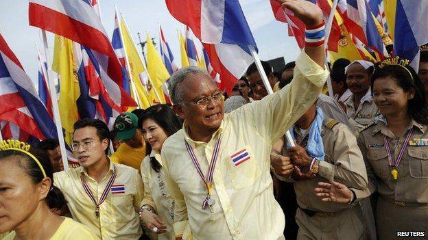 Anti-government protest leader Suthep Thaugsuban waves to his supporters as he marches near the Grand Palace on Coronation Day in Bangkok on 5 May 2014