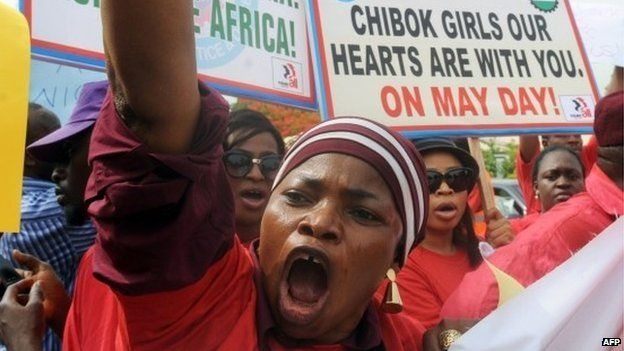 Members of civil society groups hold placards and shout slogans as they protest the abduction of Chibok school girls during a rally in Abuja on 6 May 2014