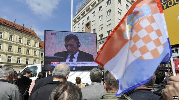 People in a square in central Zagreb watch the verdict being read out against former Croatian at The Hague war crimes tribunal in 2011