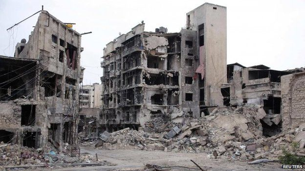 Damaged buildings near the hotel destroyed by an explosion in Aleppo's Old City on 8 May 2014
