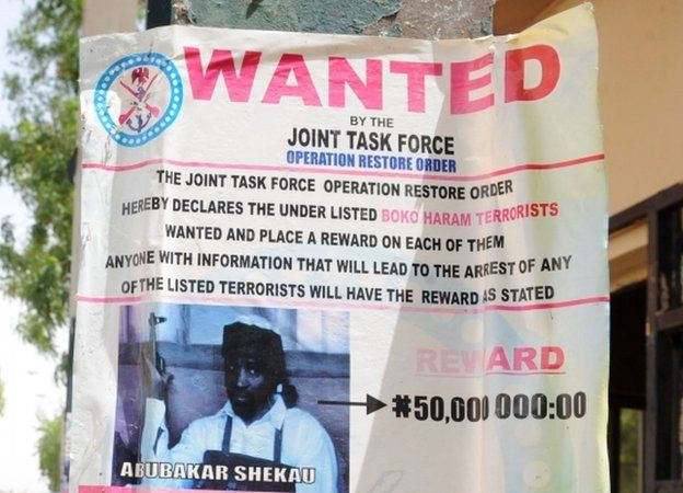 A poster displayed in Maiduguri, Nigeria, shows the photograph of Abubakar Shekau, leader of the militant Islamist group Boko Haram, declared wanted by the Nigerian military with a reward for information that could lead to his capture -1 May 2013