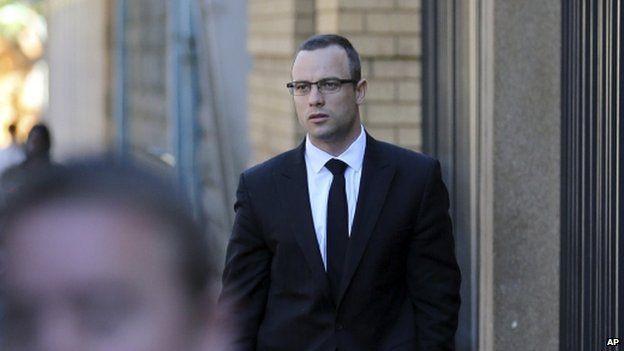 Oscar Pistorius walks towards the high court in Pretoria on Tuesday