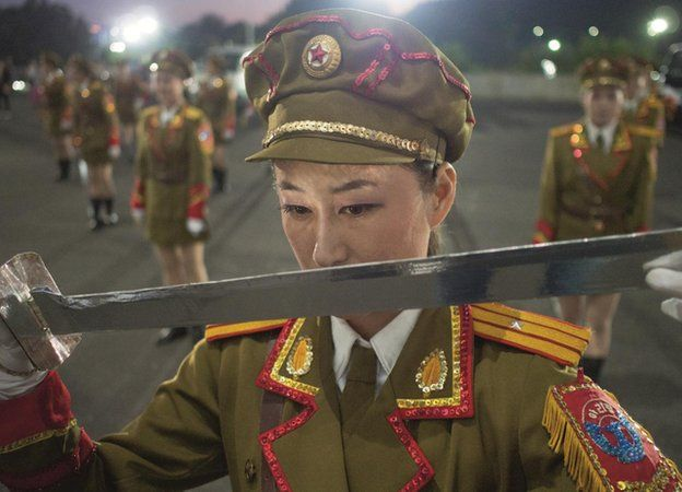 Ri Hyang Yon, 21, dancer in the Arirang Games, during a practice session in the car park, May Day Stadium, Pyongyang