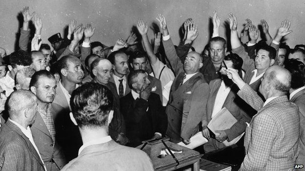 Sammarinese vote at a polling station in the 1955 general election