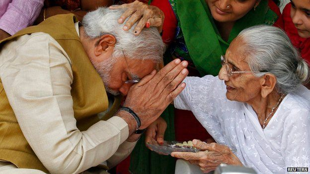 Narendra Modi with his mother in Gandhinagar on 16 May 2014