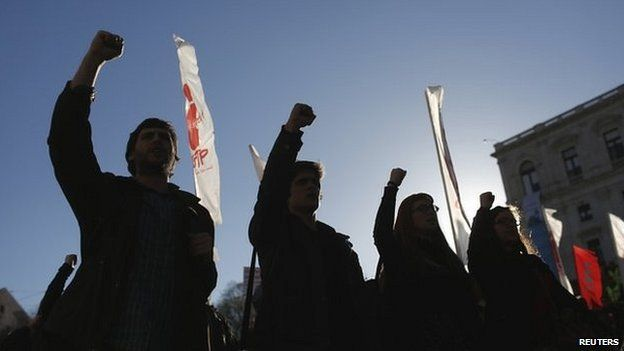 Members of the youth section of the General Confederation of Portuguese Workers (CGTP) union shout slogans during a demonstration against the government's austerity measures