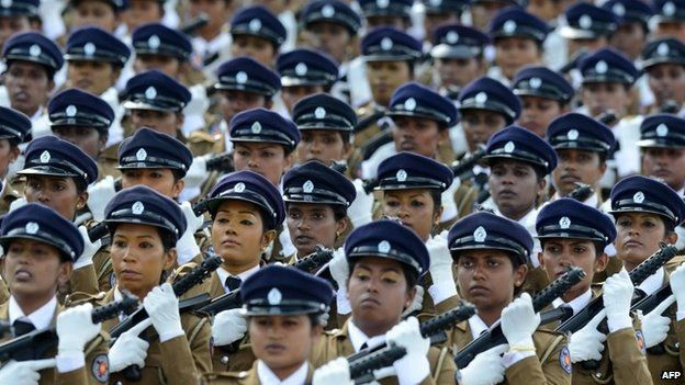 Sri Lankan policewomen march during a Victory Day parade in the southern town of Matara, 18 May 2014