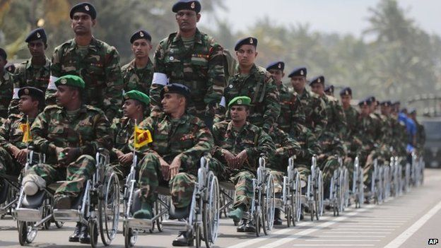 Sri Lankan war amputee soldiers participate in a Victory Day parade in Matara, 18 May 2014
