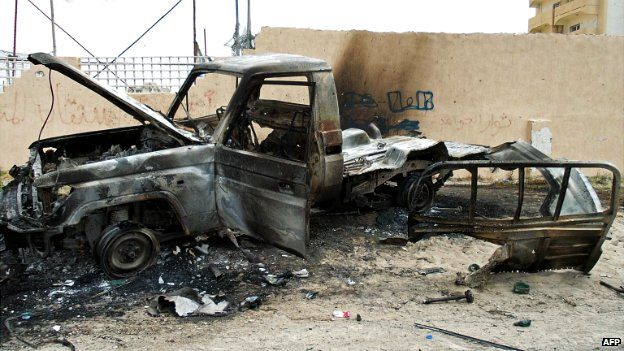 A vehicle destroyed by clashes on the road leading to Tripoli's airport - 19 May 2014