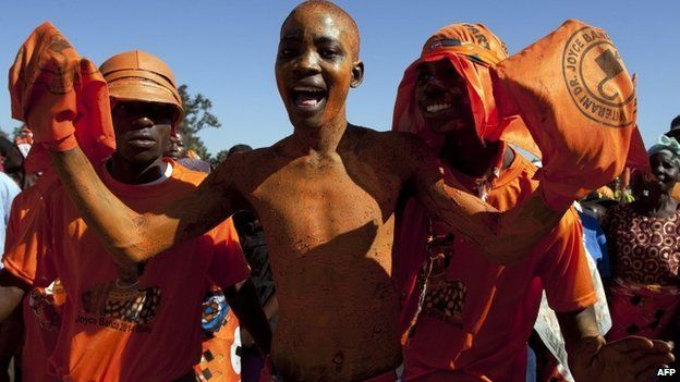 Supporters of Malawi's incumbent President Joyce Banda cheer during her final campaign rally at Songani village on the outskirts of the city of Zomba, the former capital of Malawi on 17 May 2014