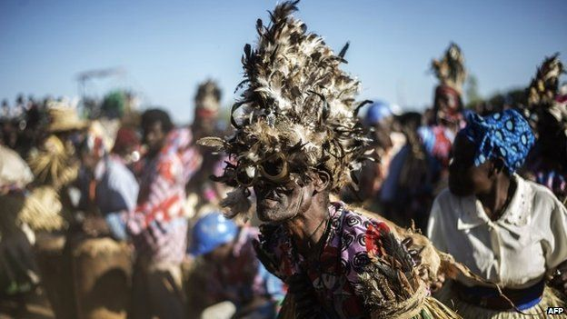 Malawian traditional dancers perform during the last campaign rally of presidential candidate Peter Mutharika on 17 May 2014 in Goliati