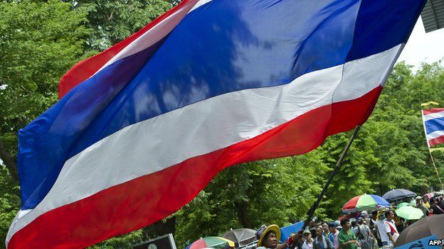 Thai protestor waving flag