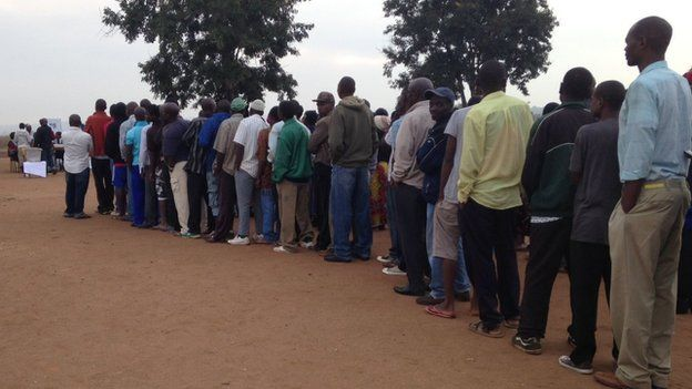 People queuing to vote