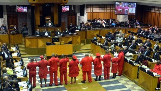 Members of the Economic Freedom Fighters (EFF) are sworn in as a member of the South African Parliament, on 21 May 2014