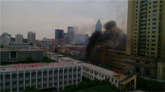 """Smoke in Urumqi (photo from Weibo user """"Manga""""), 22 May"""