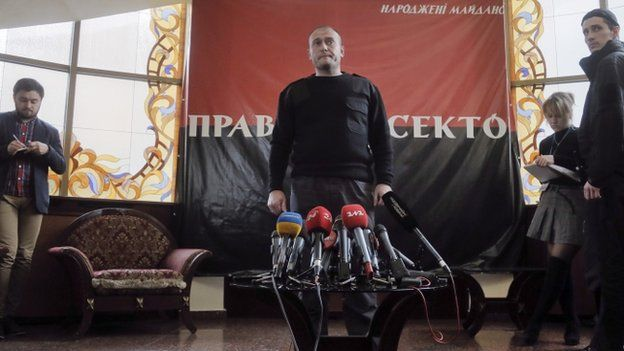 The leader of ultranationalist group Right Sector, Dmytro Yarosh, centre, pauses, during his press statement, in Kiev, Ukraine, Tuesday, March 25, 2014.