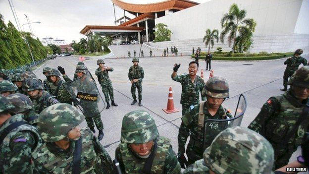"""MAY 22, 2014 AP03 Thai soldiers take control during a coup at the Army Club where Thailand""""s army chief held a meeting with all rival factions in central Bangkok"""
