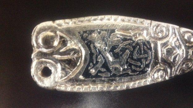 silver strap end