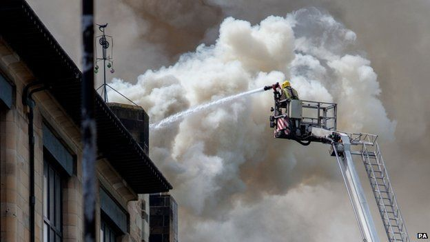fireman pouring water on Glasgow School of Art