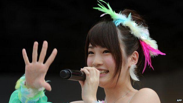 This picture taken on 8 June 2013 shows Japanese girls' pop group AKB48 member Rina Kawaei during the group's concert at the Yokohama stadium.