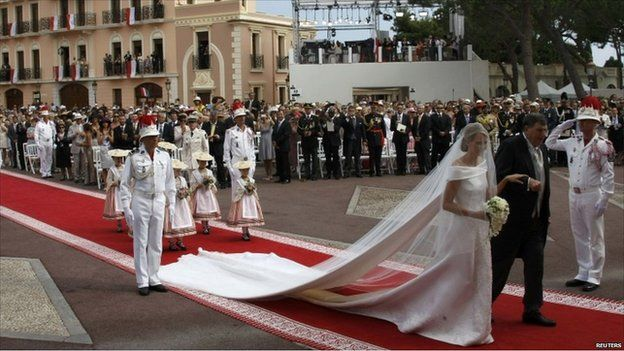 Prince Albert and Princess Charlene marrying in 2011