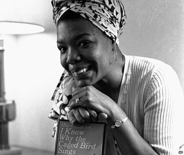 Maya Angelou poses with a copy of her book I Know Why the Caged Bird Sings in 1971 in Los Angeles, US
