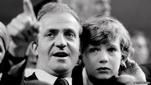 Juan Carlos, King of Spain, and his son the Prince Felipe watch a tennis match in Madrid, Spain in 1977