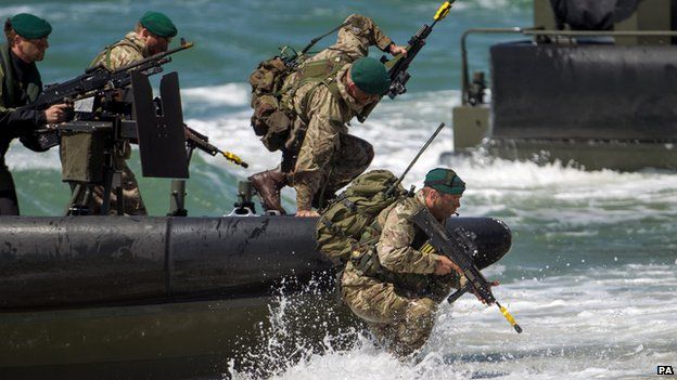 Soldiers running off an amphibious vehicle