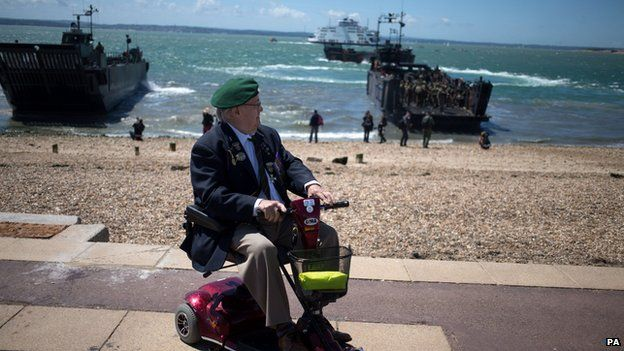 Veteran Fred Perkins watching the staged beach invasion near Southsea Common