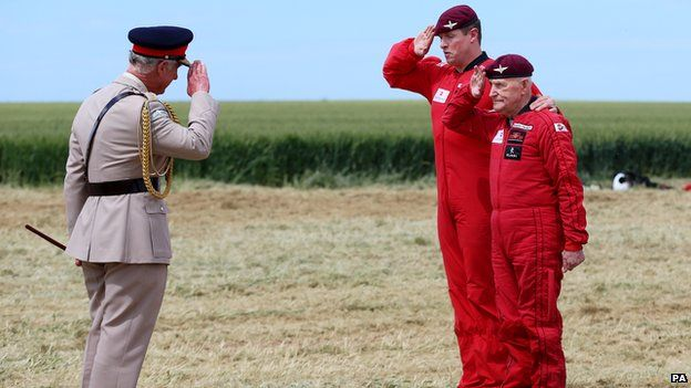 Prince Charles saluting Jock Hutton before his parachute jump
