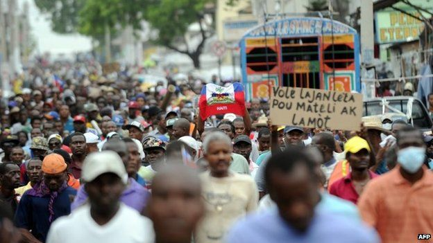 Demonstrators march during an anti-government protest in Port-au-Prince, Haiti, 5 June 2014