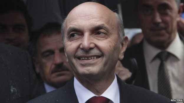 Leader of the biggest opposition party Democratic League of Kosovo (LDK) Isa Mustafa attends an election rally in the western Kosovo town of Peja June 1