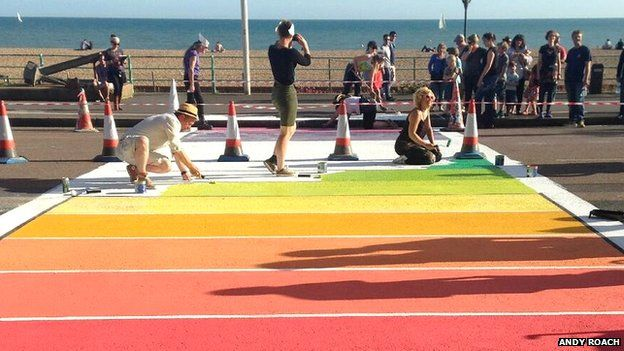 Artists working on the rainbow crossing