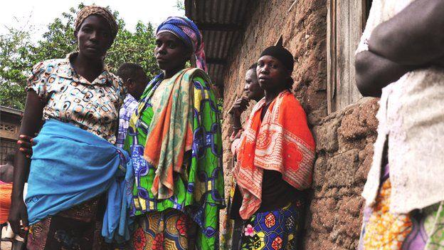 Fidela (in the blue skirt on the left)